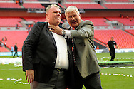 Rotherham United Manager Steve Evans is jokingly  strangled by Rotherham United Chairmen Tony Stewart after the game.  Skybet football league one play off final match , Leyton Orient  v Rotherham Utd at Wembley Stadium in  London on Sunday 25th May 2014.<br /> pic by John Patrick Fletcher, Andrew Orchard sports photography.