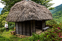 Thatched Henro Hut - Henro Goya Huts  are often somewhat exposed to the elements, and usually more suitable for a rest or nap rather than an overnight stay except in a pinch. These huts have been built through volunteer and local community efforts and provide a welcome place to rest or nap.  Uta Ichiyo a Japanese architect designed many of the more modern of these huts, although they were built by volunteers and financed by local authorities.  The ultimate aim is to create 88 of these huts for the convenience of all 88 temples.