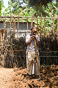 May0016089 . Daily Telegraph..Features..A woman works her plot of land on Nkombo Island in south west Rwanda, many of the island's inhabitants lost their homes to an earthquake several years ago. The islands inhabitants have received help from  Rwanda Aid, a British charity and recipient of funds from the Daily Telegraph's 2005 Christmas appeal...The pop group Keane have helped to fund 5 homes on the island with built in composting toilets and water filtration.  ..Rwanda was the scene of a brutal civil and genocide which ended in 1994 leaving behind 800,000 dead, hundreds of thousands of refugees, many orphans suffering with mental trauma . Still recovering from the civil war the small,landlocked central African state is one of the poorest countries in the world with three quarters of it's 10 million population living below the poverty line and is a huge recipient of foreign aid....Rwanda 28 August 2009