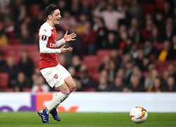 Arsenal's Mesut Ozil appears dejected after failing to collect the ball during the UEFA Europa League round of 32 second leg match at the Emirates Stadium, London.