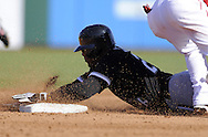 TEMPE, AZ - MARCH 4:  Andruw Jones #25 of the Chicago White Sox slides safely into second base against the Los Angeles Angels on March 4, 2010 at Tempe Diablo Stadium in Tempe, Arizona. (Photo by Ron Vesely)