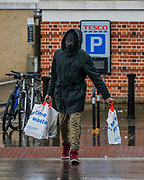 The shopping still has to be done - The first heavy rain doesn't stop, but greatly reduces, outdoor activity around Clapham Common. The 'lockdown' continues for the Coronavirus (Covid 19) outbreak in London.