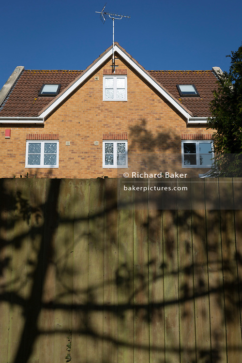 A local house and boundary fence on a nineteen-eighties, middle-class housing estate on 21st April 2019, in Nailsea, North Somerset, England
