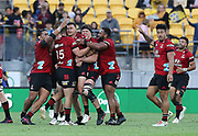 Crusaders David Havili is swamped by teammates after kicking the winning drop goal. Super Rugby Aotearoa. Hurricanes v Crusaders, Sky Stadium, Wellington. Sunday 11th April 2021. Copyright photo: Grant Down / www.photosport.nz