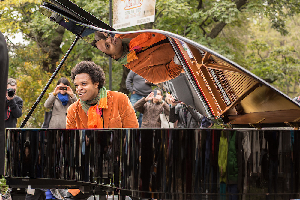 ELEW, Eric Lewis, plays for the crowd at the Jazz and Colors festival in Central Park. Lewis styles himself as a rockjazz pianist.
