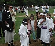 Sean Puffy Combs & Kids.Bad Boy vs. Rocafella Baseball Game.To benefit disadvantaged kids.Stony Park.Easthampton, NY.July 4th, 2001.Photo by Celebrityvibe.com..