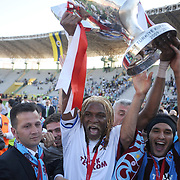 Jubilant Trabzonspor players Rigobert Song BAHANAG (C) and Gustavo COLMAN (R) lifting up the cup at the ceremony during their after the Turkey Cup final match Trabzonspor between Fenerbahce at the GAP Arena Stadium at Urfa Turkey on wednesday, 05 May 2010. Photo by TURKPIX