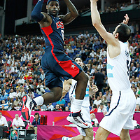 10 August 2012: USA LeBron James passes the ball during 109-80 Team USA victory over Team Argentina, during the men's basketball semi-finals, at the North Greenwich Arena, in London, Great Britain.