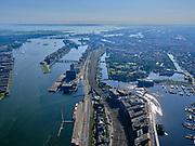 Nederland, Noord-Holland, Gemeente Amsterdam; 02-09-2020;  Oosterdok en Oosterdokseiland (ODE) ook bekend als Stationseiland. Kranen bij de nieuwbouw van Booking.com. Zicht op Piet Heinkade en Oostelijk Havengebied. IJburg in de verte.<br /> Oosterdok and Oosterdokseiland (ODE) also known as Stationseiland. <br /> <br /> luchtfoto (toeslag op standaard tarieven);<br /> aerial photo (additional fee required)<br /> copyright © 2020 foto/photo Siebe Swart