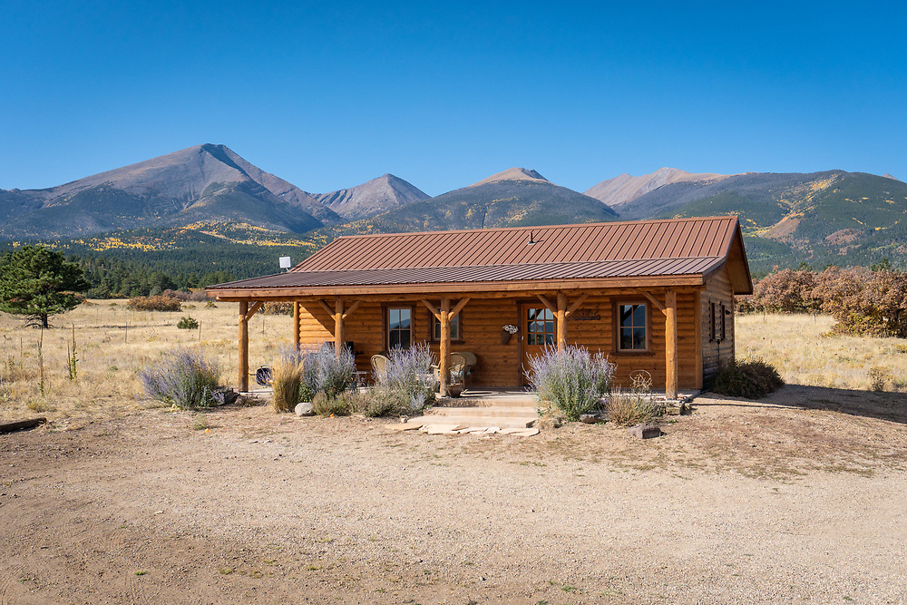 Robin Wallerich's cabin near Hillside, CO, stands on the prairie between a flowing irrigation ditch and the dramatic Sangre de Cristo Range.