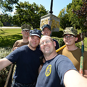 BANGOR Maine,  -- 8/8/15 - A team of US Navy Reservists poses at the USS Maine Memorial in downtown Bangor on Saturday. These reservists, from Navy Operational Support Center, Bangor, spent the afternoon spreading mulch around the memorial's pathways. USS Maine, (ACR-1) an armored cruiser commissioned in 1895, sank in Havana harbor in 1898, just prior to the Spanish-American War. (U.S. Navy Selfie Photo by Chief Mass Communication Specialist Roger S. Duncan)
