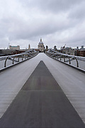 Scene looking over a very quiet Millennium Bridge towards St Pauls Cathedral as the national coronavirus lockdown three continues on 28th January 2021 in London, United Kingdom. Following the surge in cases over the Winter including a new UK variant of Covid-19, this nationwide lockdown advises all citizens to follow the message to stay at home, protect the NHS and save lives.