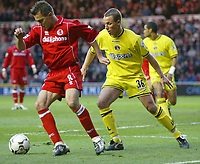 Photo. Andrew Unwin.<br /> Middlesbrough v Charlton Athletic, Barclaycard Premier League, Riverside Stadium, Middlesbrough 13/12/2003.<br /> Middlebrough's Szilard Nemeth (l) shields the ball from Charlton's Chris Perry (r).