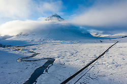 Aerial view covered winter landscape of Glen Coe in Scottish Highlands, Scotland, UK