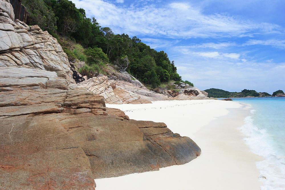 Rocks on a tropical island beach, Pulau Redang, Malaysia <br /> <br /> Editions:- Open Edition Print / Stock Image