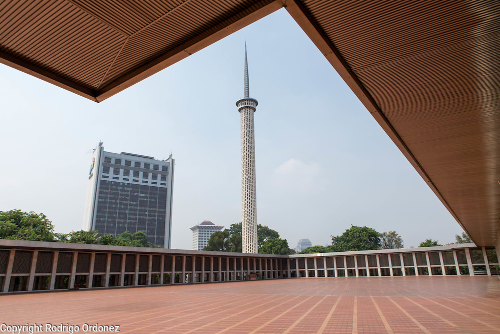 General view of the minaret tower and the courtyard of Istiqlal Mosque, in Central Jakarta, Indonesia. Istiqlal is the largest mosque in Southeast Asia. It was completed in 1978 and uses steel and marble as the main materials.