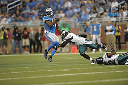 DETROIT - SEPTEMBER 19: Wide receiver Calvin Johnson #81 of the Detroit Lions spins away from a tackle during the game against the Philadelphia Eagles on September 19, 2010 at Ford Field in Detroit, Michigan. (Photo by Drew Hallowell/Getty Images)  *** Local Caption *** Calvin Johnson