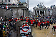 Lifeguards parade past Cornhill during the Lord Mayor's Show in the City of London. Alderman and Rt Hon The Lord Mayor of London, Roger Gifford, a merchant banker with Swedish bank SEB is the 685th in the City of London's ancient history. The new Mayor's procession consists of a 3-mile, 150-float parade of commercial and military organisations going back to medieval times. This is the oldest and longest civic procession in the world that has survived the Plague and the Blitz, today one of the best-loved pageants. Henry Fitz-Ailwyn was the first Lord Mayor (1189-1212) and ever since, eminent city fathers (and one woman) have taken the role of the sovereign's representative in the City - London's ancient, self-governing financial district. The role ensured the King had an ally within the prosperous enclave. .