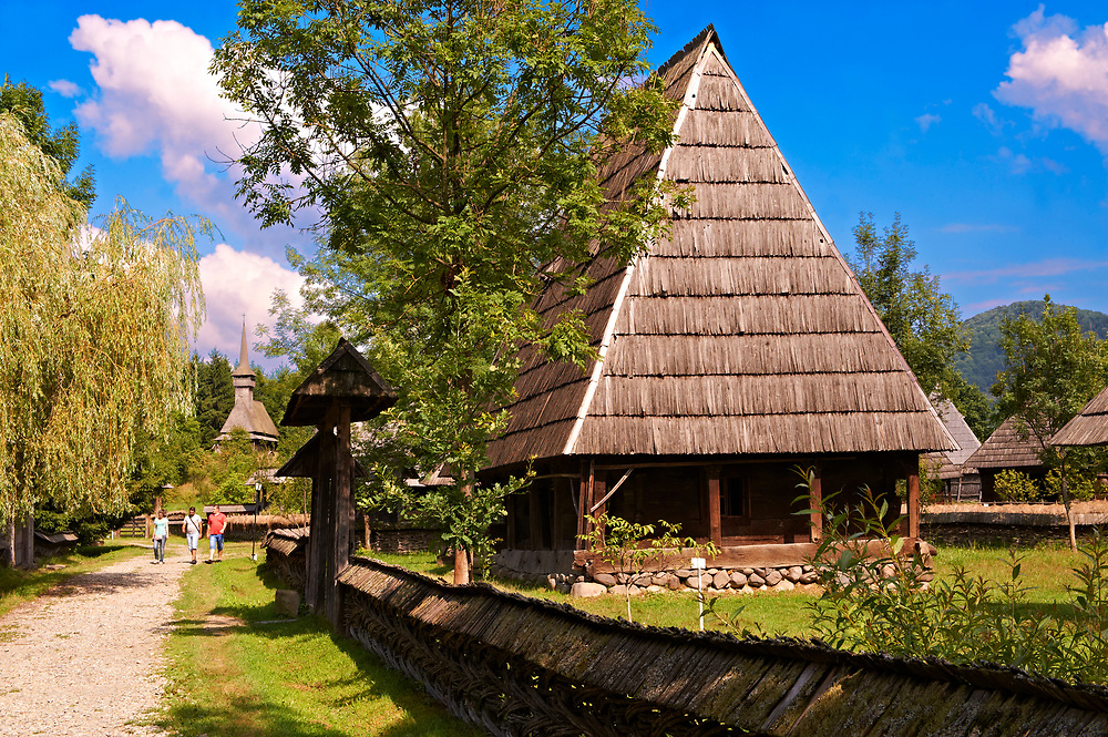 19th century traditional farm house & street of the Iza Valley, The Village museum near Sighlet, Maramures, Northern Transylvania .<br /> <br /> Visit our ROMANIA HISTORIC PLACXES PHOTO COLLECTIONS for more photos to download or buy as wall art prints https://funkystock.photoshelter.com/gallery-collection/Pictures-Images-of-Romania-Photos-of-Romanian-Historic-Landmark-Sites/C00001TITiQwAdS8