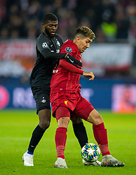 SALZBURG, AUSTRIA - Tuesday, December 10, 2019: Liverpool's Roberto Firmino and FC Salzburg's Jérôme Onguéné during the final UEFA Champions League Group E match between FC Salzburg and Liverpool FC at the Red Bull Arena. (Pic by David Rawcliffe/Propaganda)