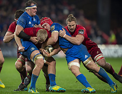 December 30, 2018 - Limerick, Ireland - John Ryan of Munster tackled by Rhys Ruddock and James Ryan of Leinster during the Guinness PRO14 match between Munster Rugby and Leinster Rugby at Thomond Park in Limerick, Ireland on December 29, 2018  (Credit Image: © Andrew Surma/NurPhoto via ZUMA Press)