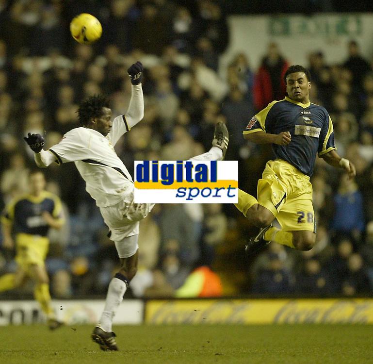 Photo: Aidan Ellis.<br /> Leeds United v Derby County. Coca Cola Championship. 09/12/2006.<br /> Leeds Ugo Ehiogu clears from Derby's Giles Barnes