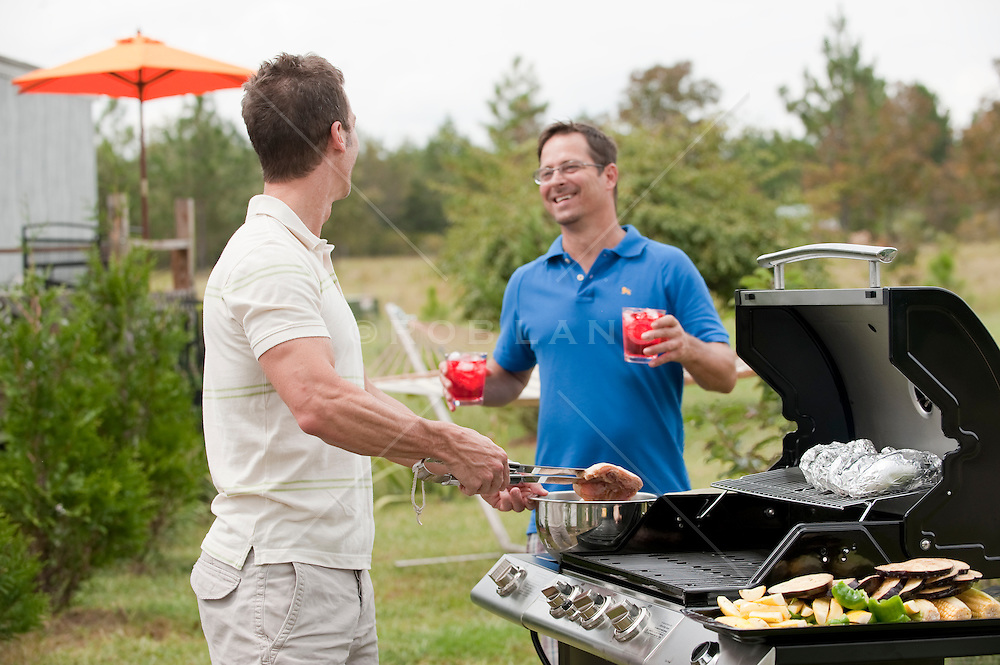Backyard barbecue with two men