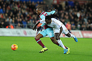 Bafetimbi Gomis of Swansea city is fouled by Angelo Ogbonna of West Ham. Barclays Premier league match, Swansea city v West Ham Utd at the Liberty Stadium in Swansea, South Wales  on Sunday 20th December 2015.<br /> pic by  Andrew Orchard, Andrew Orchard sports photography.
