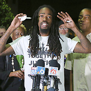 Organizer Miles Mulrain of Let Your Voice Be Heard speaks to the crowd during a vigil to honor deceased Orlando Police officer Master Sgt. Debra Clayton who was shot and killed as she attempted to stop and question accused gunman Markeith Loyd, at an Orlando Walmart, on January 10, 2017 in Orlando, Florida. Orange County deputy Norm Lewis who was also killed on his motor patrol while responding to Clayton's shooting was also honored.  (Alex Menendez via AP)