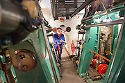 ****COPY HERE****  (https://www.dropbox.com/s/5mg81qiiuy22tre/adamson.rtf?dl=0)   © Licensed to London News Pictures. 02/12/2014. Liverpool , UK . Volunteer John Hake in the partially restored engine room. The only surviving steam powered tug tender, the Daniel Adamson, is being completely renovated by a team of volunteers in Liverpool. The vessel, which has had 90,000 man hours already spent on it, was bought for only one pound is the awaiting the decision of the Heritage Lottery Fund on an application of £3.6m to bring her back to her full glory.  . Photo credit : Stephen Simpson/LNP<br /> <br /> COPY HERE https://www.dropbox.com/s/5mg81qiiuy22tre/adamson.rtf?dl=0