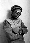 Youth wearing dark glasses. Photo by Richard Saunders 1983