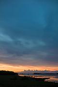 Skyscene of setting sun over Dunvegan Loch, the Isle of Skye in Scotland
