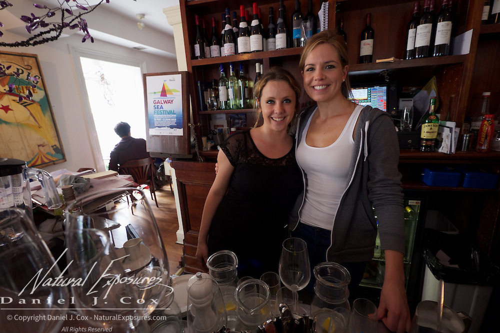 Allison Daniels and her fellow waitress pose for a photo at the Artisan Restaurant in Galway, Ireland.