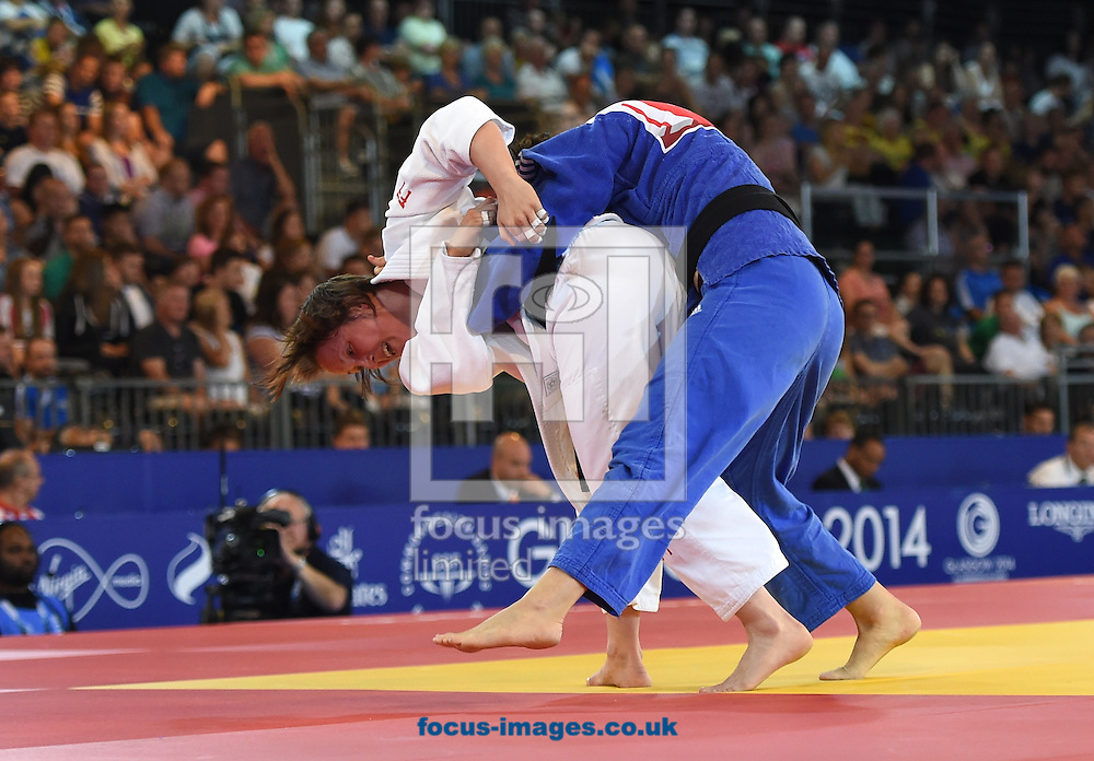 Faith Pitman ENG (white) attempts a throw on Fortier Valois CAN during the women's 63k quarter finals on day two of the judo at the  SECC Precinct, Glasgow<br /> Picture by Alan Stanford/Focus Images Ltd +44 7915 056117<br /> 25/07/2014