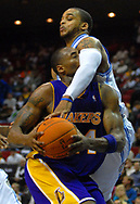 Los Angeles Lakers guard Kobe Bryant, left, is fouled by Orlando Magic guard Jameer Nelson during the second half of their basketball game in Orlando, Florida.