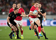 Josh Adams of Wales runs with the ball during the Rugby World Cup bronze final match between New Zealand and Wales Friday, Nov, 1, 2019, in Tokyo. New Zealand defeated Wales 40-17.  (Flor Tan Jun/Espa-Images-Image of Sport)