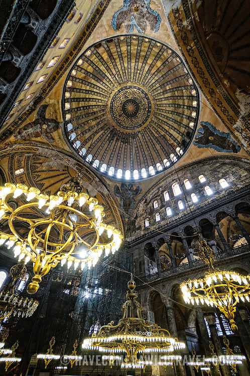 The ornately decorated ceiling and lights of Hagia Sophia, Istanbul, Turkey. Originally built as a Christian cathedral, then converted to a Muslim mosque in the 15th century, and now a museum (since 1935), the Hagia Sophia is one of the oldest and grandest buildings in Istanbul. For a thousand years, it was the largest cathedral in the world and is regarded as the crowning achievement of Byzantine architecture.