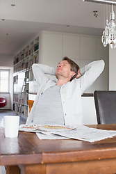 Mature man relaxing on chair