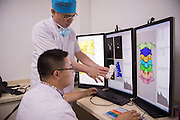 CHANGCHUN, CHINA - JUNE 23: (CHINA OUT)<br /> <br /> Man Recovered With 3D Printed Cervical Vertebra <br /> <br /> Doctors use a 3D printer at the Second Hospital of Jilin University on June 23, 2015 in Changchun, Jilin Province of China. 66-year-old Fu Zuohua, who has cervical vertebra hyperosteogeny, received a surgery with a 3D printed cervical vertebra implant made of titanium on June 19, and he recoverd to a better condition.<br /> ©Exclusivepix Media