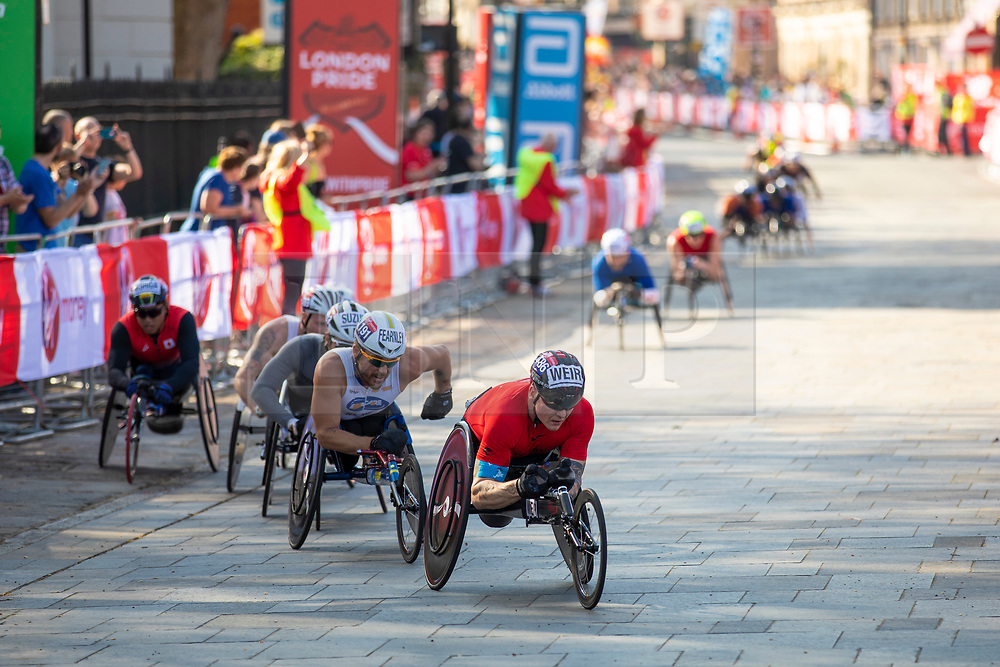 © Licensed to London News Pictures. 22/04/2018. London, UK. British Paralympic Athlete DAVID WEIR (centre) passes the Cutty Sark in Greenwich during the Virgin Money London Marathon 2018. Photo credit: Rob Pinney/LNP