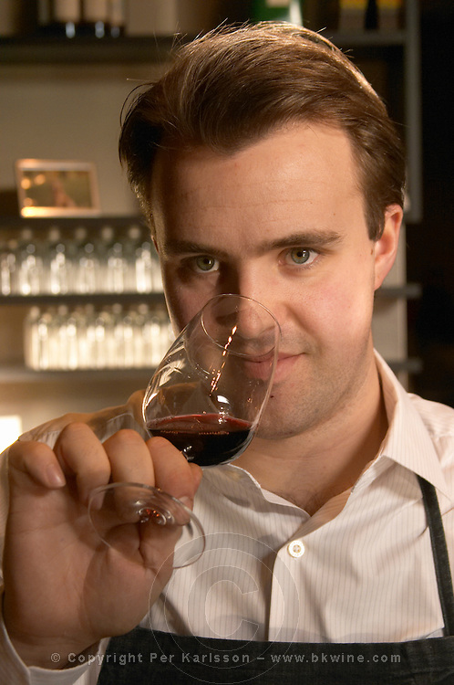 The interior of the wine bar Terrenos Vinotek. The head waiter Michael Mobach tasting a glass of wine.  Stockholm, Sweden, Sverige, Europe