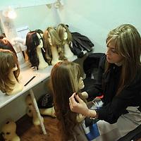 Miri Beillin, an ultra orthodox Jewish woman, works as a stylist during a fashion show for ultra orthodox women.