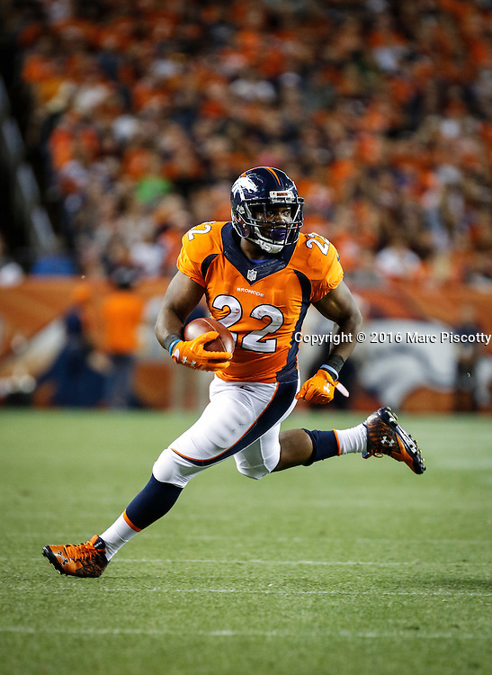 Denver Broncos running back C.J. Anderson (#22) runs while playing against the Los Angeles Rams at Sports Authority Field at Mile High in Denver, Co. August 27, 2016. (Photo by Marc Piscotty / © 2016)