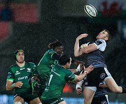 Tom Williams under pressure from Niyi Adeolokun of Connacht for the high ball<br /> <br /> Photographer Simon King/Replay Images<br /> <br /> Guinness PRO14 Round 6 - Ospreys v Connacht - Saturday 2nd November 2019 - Liberty Stadium - Swansea<br /> <br /> World Copyright © Replay Images . All rights reserved. info@replayimages.co.uk - http://replayimages.co.uk
