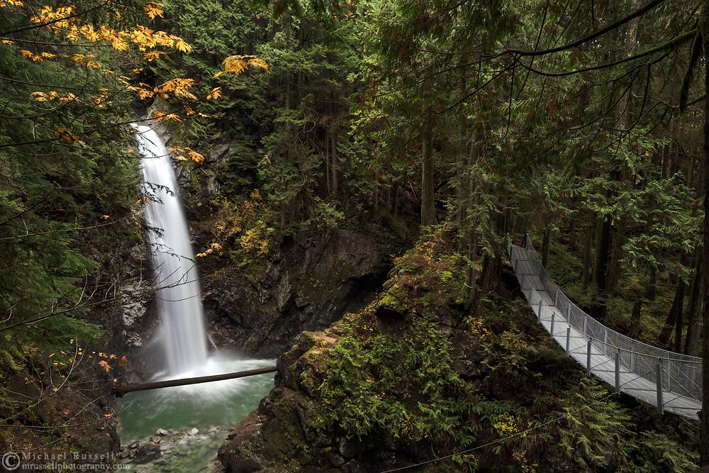 Cascade Falls and the suspension bridge at Cascade Falls Regional Park near Mission, British Columbia, Canada