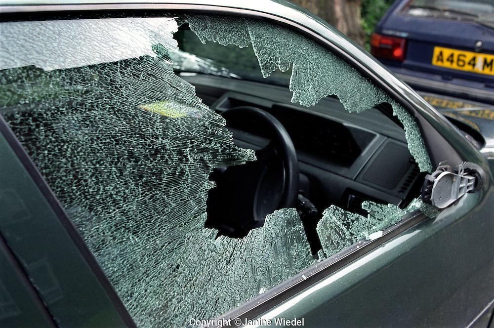 Vandalised car with smashed window.
