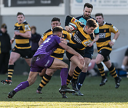 Newports' Matt O'Brien forces himself through the tackle of Ebbw Vales' Stefan Thomas.<br /> <br /> Photographer Simon Latham/Replay Images<br /> <br /> Principality Premiership - Newport v Ebbw Vale - Sunday 4th February 2018 - Rodney Parade - Newport<br /> <br /> World Copyright © Replay Images . All rights reserved. info@replayimages.co.uk - http://replayimages.co.uk