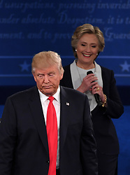 ST. LOUIS, Oct. 10, 2016 (Xinhua) -- Democratic presidential candidate Hillary Clinton (R) and Republican presidential candidate Donald Trump attend the second presidential debate at Washington University in St. Louis, Missouri, the United States, Oct. 9, 2016. The second of three U.S. presidential debates between the Democratic and Republican nominees Hillary Clinton and Donald Trump was held in Washington University on Sunday.  (Xinhua/Yin Bogu) (wtc) (Credit Image: © Yin Bogu/Xinhua via ZUMA Wire)
