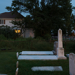 August 4, 2017 - Tangier Island, VA - Graves populate many yards on Tangier Island.  Large concrete slabs over the sites are meant to keep the coffins from rising during periods of flooding.<br /> Photo by Susana Raab/Institute