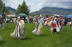 WY: Wyoming, Cody: Dancing at Plains Indian June Powwow...Photo #: yellow548..Photo copyright Lee Foster, 510/549-2202, lee@fostertravel.com, www.fostertravel.com..
